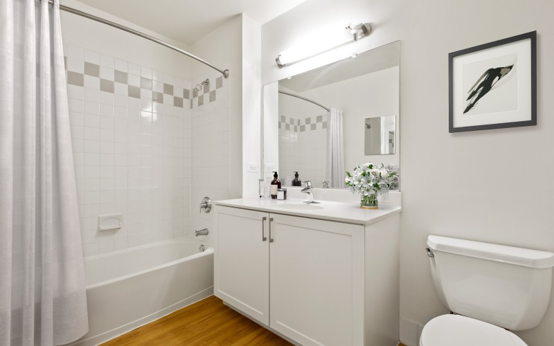 bright bathroom with shower and tub