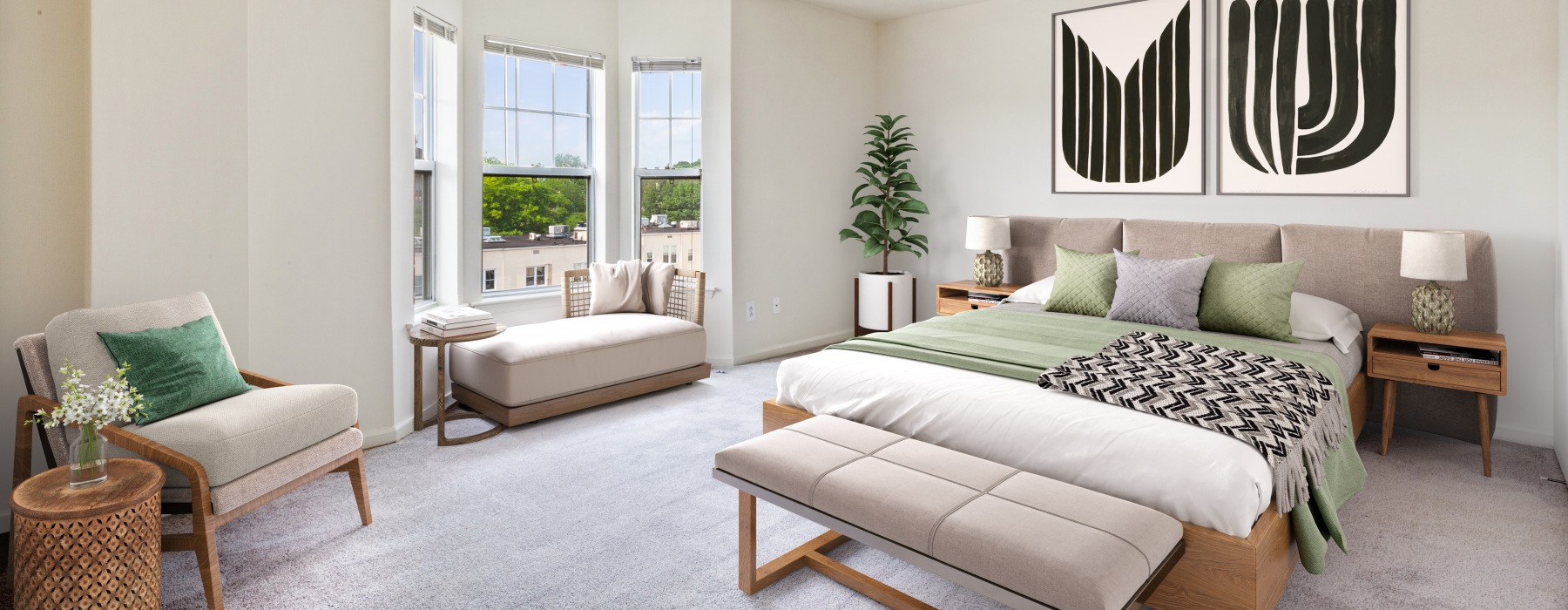 large bedroom with oversized windows, queen bed and seating area